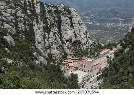 The Santa Maria de Montserrat Abbey in Monistrol de Montserrat, Catalonia, Spain. Famous for the Virgin of Montserrat. - stock photo