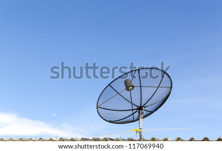 The satellite dish with the blue sky background - stock photo