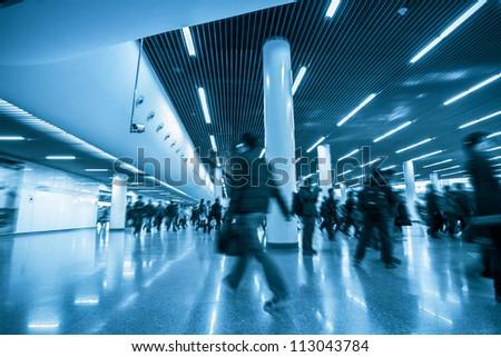 the scene of shanghai subway station,passengers motion blur - stock photo