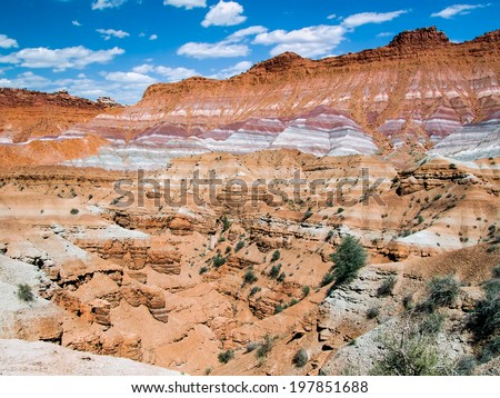 The scenery of many movie westerns, the colorful cliffs of the Paria Valley are a part of Utah's Grand Staircase-Escalante National Monument. - stock photo