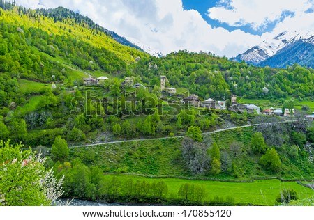 The scenic Bogreshi village on the slope in Enguri gorge, surrounded by green forests, Georgia.