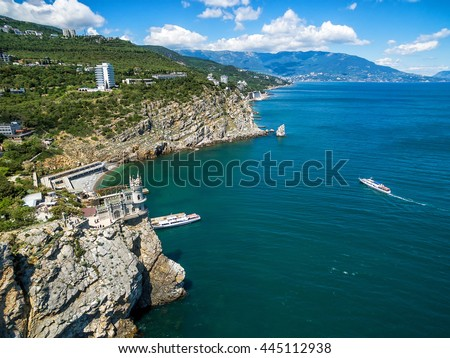 The scenic coast of Crimea with castle Swallow's Nest on the rock in the Black Sea, Russia. This castle is a symbol of Crimea. - stock photo