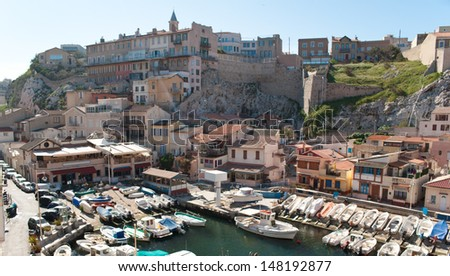 the scenic houses located on the rock and around the small haven inside of modern city of Marseille, France