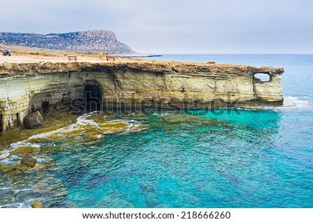 The scenic rock with a hole is the favorite place for wedding photo sessions among locals, Cavo Greco, Ayia Napa, Cyprus. - stock photo
