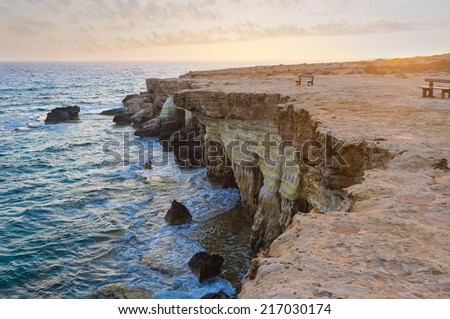The scenic rocky cliffs of Cavo Greco in the lights of sunset, Cyprus. - stock photo