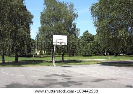 The school playground basketball in the summer heat without the players - stock photo