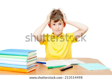 the schoolboy ponders the difficult task - stock photo