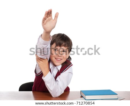 The schoolboy with the lifted hand is ready to answer - stock photo
