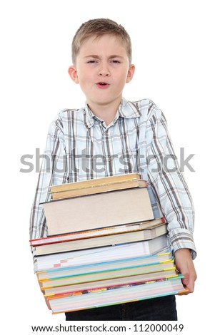 The schoolchild with a huge pile of heavy books in hands, on white background.