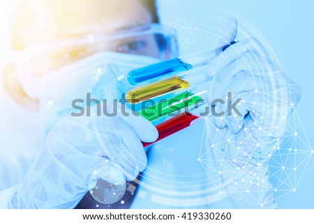 The scientist test or research for decorate or design science concept,science content,science concept,science background,Scientist female working in lab and looking test tube,science education. - stock photo