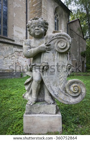 The sculpture of a boy with a harp - stock photo