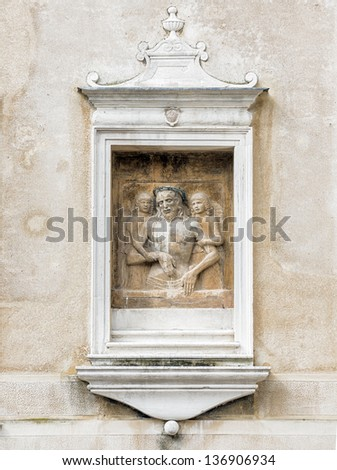 The sculpture section explanation of the Bible on the ancient walls of the houses - Venice, Italy - stock photo