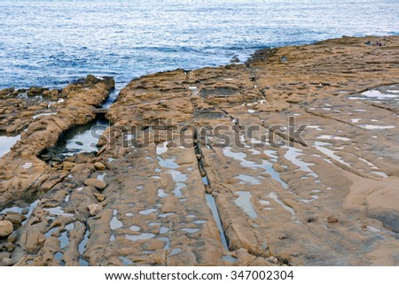 The sea and rocks at the shore.