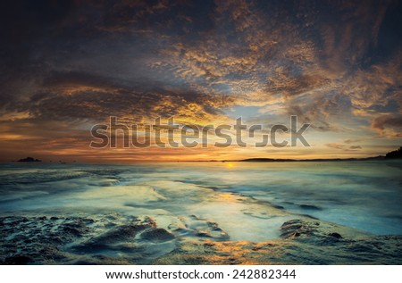 The sea at the Tanah Lot temple, in Bali island, indonesia - stock photo