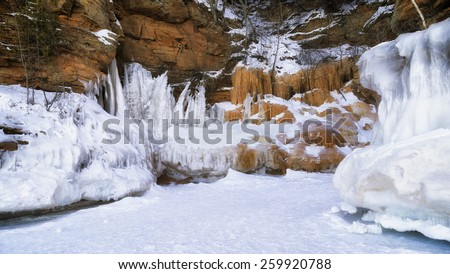 The sea caves become covered in ice in the winter - stock photo