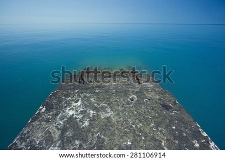The sea horizon from the breakwater. - stock photo