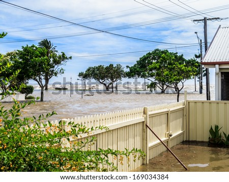 The sea washing over the sea wall and flooding the street in Sandgate, Brisbane - stock photo