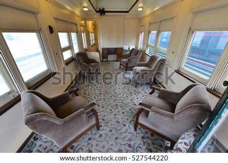 The seats inside of a vintage American railway carriage.