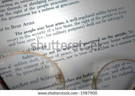 The second amendment to the United States constitution is shown, highlighted by a beam of light.