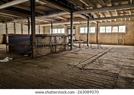 The second floor in an old abandoned factory. - stock photo