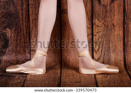 The second position in classical ballet. Slender legs of a ballerina in pointe shoes. Photo closeup.