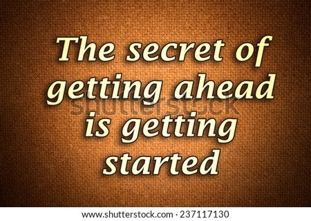 The secret of getting ahead is getting started.A famous inspirational motivating quote by Mark Twain.Grunge background with gradient effect - stock photo