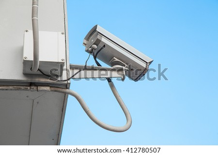 The security camera against blue sky