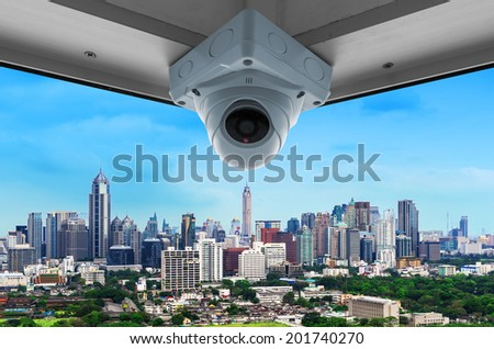 The security cameras on a balcony high building. City view  - stock photo
