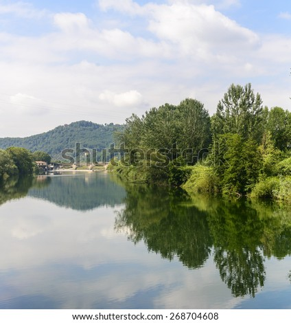 The Serchio river (Lucca, Tuscany, Italy) in a sunny summer morning - stock photo