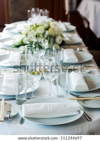 the served festive table with flowers