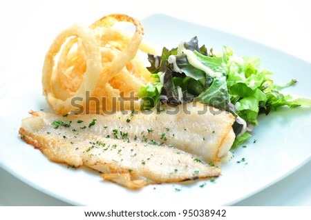 The sesoning fillet fish steak with oning rings - stock photo