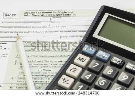 The settlement of annual tax, US tax forms - stock photo