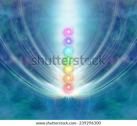The Seven Chakras - Ethereal blue energy formation background with a central column of the seven chakras in a beam of spiraling light - stock photo