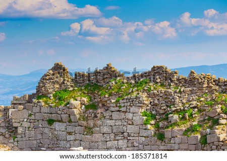 The seventh century Sanctuary of the ancient city of Troy (700BC - 1BC) with ruins of twelve cities built on top of each other (Troy I to Troy XII), in Anatolia, Turkey. - stock photo