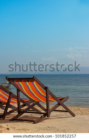 The Several beach chairs on the background of the sea