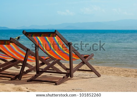 The Several beach chairs on the background of the sea - stock photo