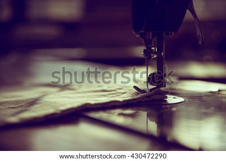 the sewing machine and item of clothing, old sewing machine,vintage style - stock photo