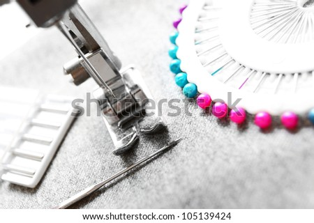 The sewing machine and needles. - stock photo