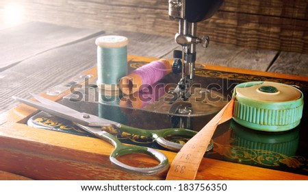 The sewing machine and tools. Vintage sewing . - stock photo