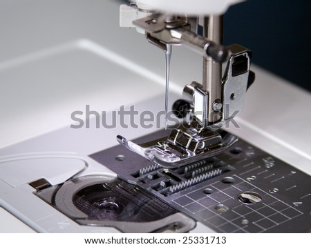 The sewing-machine costs on a table and is ready to work - stock photo