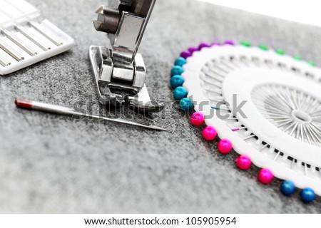 The sewing machine, needles. - stock photo