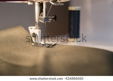 the sewing process at the stage of needle stitching