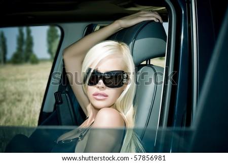 The sexual blonde in underwear in car salon - stock photo