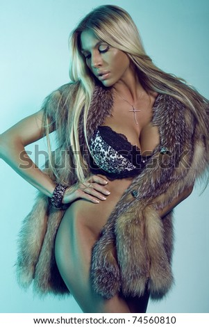 The sexual woman in underwear and in a fur coat. Fashion art photo - stock photo