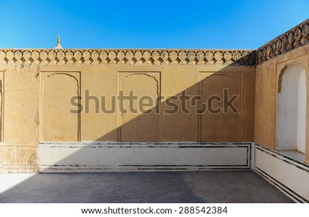 The shadow and the wall under the blue sky. - stock photo
