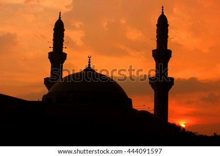 the shadow of a mosque at sunset