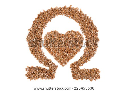The shape of the heart and the omega symbol made from flax seeds on a white background - stock photo