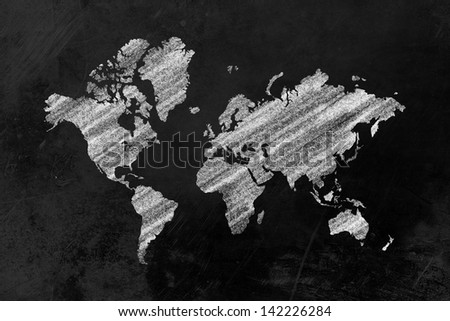 the shape of the world map drawn on a blackboard - stock photo