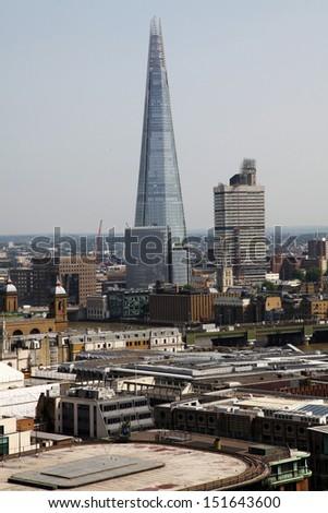 The Shard and Southwark Bridge in London, United Kingdom  - stock photo
