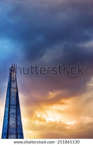 The Shard London skyscraper against dusk lit sky - stock photo